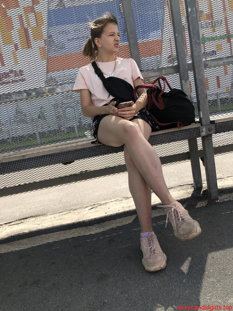 Bus Stop Girl Sitting with Crossed Legs Street Candid
